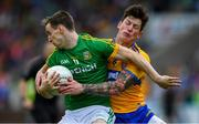 7 July 2019; Bryan McMahon of Meath in action against Aaron Fitzgerald of Clare during the GAA Football All-Ireland Senior Championship Round 4 match between Meath and Clare at O'Moore Park in Portlaoise, Laois. Photo by Piaras Ó Mídheach/Sportsfile