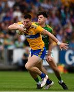 7 July 2019; Jamie Malone of Clare in action against Séamus Lavin of Meath during the GAA Football All-Ireland Senior Championship Round 4 match between Meath and Clare at O'Moore Park in Portlaoise, Laois. Photo by Sam Barnes/Sportsfile