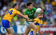 7 July 2019; Séamus Lavin of Meath gets past David Tubridy, left, and Cian O'Dea of Clare during the GAA Football All-Ireland Senior Championship Round 4 match between Meath and Clare at O'Moore Park in Portlaoise, Laois. Photo by Piaras Ó Mídheach/Sportsfile