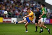 7 July 2019; Jamie Malone of Clare scores a point depite the efforts of Séamus Lavin of Meath during the GAA Football All-Ireland Senior Championship Round 4 match between Meath and Clare at O'Moore Park in Portlaoise, Laois. Photo by Sam Barnes/Sportsfile