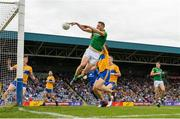 7 July 2019; Mickey Newman of Meath scores his sides second goal despite the efforts of Cillian Brennan of Clare during the GAA Football All-Ireland Senior Championship Round 4 match between Meath and Clare at O'Moore Park in Portlaoise, Laois. Photo by Sam Barnes/Sportsfile