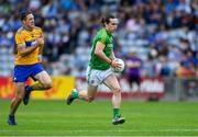 7 July 2019; Cillian O'Sullivan of Meath is chased by Gary Brennan of Clare during the GAA Football All-Ireland Senior Championship Round 4 match between Meath and Clare at O'Moore Park in Portlaoise, Laois. Photo by Piaras Ó Mídheach/Sportsfile
