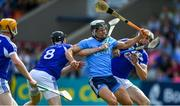 7 July 2019; Cian Boland of Dublin in action against Laois players, from left, Pádraig Delaney, John Lennon, and Ryan Mullaney during the GAA Hurling All-Ireland Senior Championship preliminary round quarter-final match between Laois and Dublin at O'Moore Park in Portlaoise, Laois. Photo by Piaras Ó Mídheach/Sportsfile