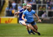 7 July 2019; Paddy Smyth of Dublin in action against Ross King of Laois during the GAA Hurling All-Ireland Senior Championship preliminary round quarter-final match between Laois and Dublin at O'Moore Park in Portlaoise, Laois. Photo by Sam Barnes/Sportsfile