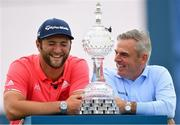 7 July 2019; Jon Rahm of Spain and tournament host Paul McGinley, right, with the trophy following his victory on day four of the 2019 Dubai Duty Free Irish Open at Lahinch Golf Club in Lahinch, Clare. Photo by Ramsey Cardy/Sportsfile