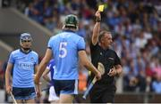 7 July 2019; Referee Alan Kelly shows Chris Crummy of Dublin a yellow card during the GAA Hurling All-Ireland Senior Championship preliminary round quarter-final match between Laois and Dublin at O'Moore Park in Portlaoise, Laois. Photo by Sam Barnes/Sportsfile
