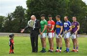 9 July 2019; Uachtaráin Cumann Lúthchleas Gael John Horan welcomes three year old Senan Ó aHannaigh, from the host club Mungret St Paul's, into a photograph with players Aaron Gillane of Limerick, Seamus Harnedy of Cork, Brendan Maher of Tipperary, Joe Phelan of Laois and Kevin Foley of Wexford, during the GAA Hurling All Ireland Senior Championship Series National Launch at Mungret St Pauls GAA Club in Limerick. Photo by Brendan Moran/Sportsfile