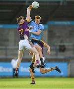 9 July 2019; Kieran Kennedy of Dublin in action against Enda Minouge of Wexford during the EirGrid Leinster GAA Football U20 Championship semi-final match between Dublin and Wexford at Parnell Park in Dublin. Photo by Eóin Noonan/Sportsfile