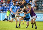 9 July 2019; Brian O'Leary of Dublin is tackled by Dylan McVeigh of Wexford during the EirGrid Leinster GAA Football U20 Championship semi-final match between Dublin and Wexford at Parnell Park in Dublin. Photo by Eóin Noonan/Sportsfile
