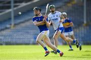 9 July 2019; Jerome Cahill of Tipperary clears his lines as Michael Kiely of Waterford looks on during the Bord Gáis Energy Munster GAA Hurling Under 20 Championship Semi-Final match between Tipperary and Waterford at Semple Stadium in Thurles, Tipperary. Photo by Piaras Ó Mídheach/Sportsfile