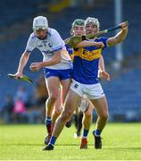 9 July 2019; Billy Power of Waterford in action against Ciarán Connolly of Tipperary, as Paddy Cadell, behind, looks on during the Bord Gáis Energy Munster GAA Hurling Under 20 Championship Semi-Final match between Tipperary and Waterford at Semple Stadium in Thurles, Tipperary. Photo by Piaras Ó Mídheach/Sportsfile