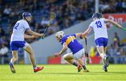 9 July 2019; Bryan O'Mara of Tipperary in action against Gavin Fives, left, and Oisín Ó Ceallaigh of Waterford during the Bord Gáis Energy Munster GAA Hurling Under 20 Championship Semi-Final match between Tipperary and Waterford at Semple Stadium in Thurles, Tipperary. Photo by Piaras Ó Mídheach/Sportsfile