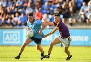 9 July 2019; Ross McGarry of Dublin is tackled by Ciaran Kavanagh of Wexford during the EirGrid Leinster GAA Football U20 Championship semi-final match between Dublin and Wexford at Parnell Park in Dublin. Photo by Eóin Noonan/Sportsfile
