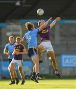 9 July 2019; Liam Coleman of Wexford in action against Donal Ryan of Dublin during the EirGrid Leinster GAA Football U20 Championship semi-final match between Dublin and Wexford at Parnell Park in Dublin. Photo by Eóin Noonan/Sportsfile