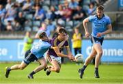 9 July 2019; Liam Coleman of Wexford is tackled by Brian O'Leary of Dublin during the EirGrid Leinster GAA Football U20 Championship semi-final match between Dublin and Wexford at Parnell Park in Dublin. Photo by Eóin Noonan/Sportsfile
