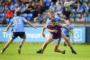 9 July 2019; Liam Coleman of Wexford is tackled by Peadar O'Cofaigh Byrne of Dublin during the EirGrid Leinster GAA Football U20 Championship semi-final match between Dublin and Wexford at Parnell Park in Dublin. Photo by Eóin Noonan/Sportsfile