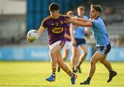 9 July 2019; Micheal Molloy of Wexford in action against Darren Maher of Dublin during the EirGrid Leinster GAA Football U20 Championship semi-final match between Dublin and Wexford at Parnell Park in Dublin. Photo by Eóin Noonan/Sportsfile