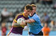 9 July 2019; Jamue Myler of Wexford in action against Eoin O'Dea of Dublin during the EirGrid Leinster GAA Football U20 Championship semi-final match between Dublin and Wexford at Parnell Park in Dublin. Photo by Eóin Noonan/Sportsfile