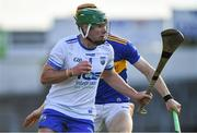 9 July 2019; Billy Power of Waterford in action against Jake Morris of Tipperary during the Bord Gáis Energy Munster GAA Hurling Under 20 Championship Semi-Final match between Tipperary and Waterford at Semple Stadium in Thurles, Tipperary. Photo by Piaras Ó Mídheach/Sportsfile