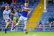 9 July 2019; Conor Bowe of Tipperary shoots to score his side's second goal as Sam Fitzgerald of Waterford closes in during the Bord Gáis Energy Munster GAA Hurling Under 20 Championship Semi-Final match between Tipperary and Waterford at Semple Stadium in Thurles, Tipperary. Photo by Piaras Ó Mídheach/Sportsfile