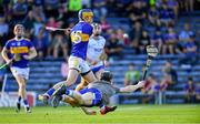 9 July 2019; Conor Bowe of Tipperary scores his side's first goal past Waterford goalkeeper Dean Beecher during the Bord Gáis Energy Munster GAA Hurling Under 20 Championship Semi-Final match between Tipperary and Waterford at Semple Stadium in Thurles, Tipperary. Photo by Piaras Ó Mídheach/Sportsfile