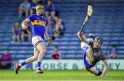 9 July 2019; Conor Bowe of Tipperary and Waterford goalkeeper Dean Beecher looks on as Bowe's shot hits the net for his side's second goal during the Bord Gáis Energy Munster GAA Hurling Under 20 Championship Semi-Final match between Tipperary and Waterford at Semple Stadium in Thurles, Tipperary. Photo by Piaras Ó Mídheach/Sportsfile