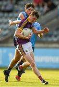 9 July 2019; Enda Minouge of Wexford in action against Niall O'Leary of Dublin during the EirGrid Leinster GAA Football U20 Championship semi-final match between Dublin and Wexford at Parnell Park in Dublin. Photo by Eóin Noonan/Sportsfile