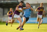 9 July 2019; Micheal Molloy of Wexford in action against Neil Matthews of Dublin during the EirGrid Leinster GAA Football U20 Championship semi-final match between Dublin and Wexford at Parnell Park in Dublin. Photo by Eóin Noonan/Sportsfile