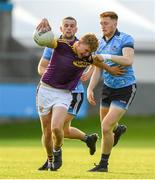 9 July 2019; Michael Kinsella of Wexford in action against Sean Farrelly of Dublin during the EirGrid Leinster GAA Football U20 Championship semi-final match between Dublin and Wexford at Parnell Park in Dublin. Photo by Eóin Noonan/Sportsfile