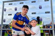 9 July 2019; Conor Bowe of Tipperary is presented with his Man of the Match award by Seán Stanley, age 7, from Gortnahoe Glengoole, Tipperary, following the Bord Gáis Energy GAA Munster U20 Hurling Championship semi-final between Tipperary and Waterford at Semple Stadium in Thurles. Photo by Piaras Ó Mídheach/Sportsfile