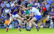 9 July 2019; Mairtín Power of Waterford in action against Gearóid O'Connor of Tipperary during the Bord Gáis Energy Munster GAA Hurling Under 20 Championship Semi-Final match between Tipperary and Waterford at Semple Stadium in Thurles, Tipperary. Photo by Piaras Ó Mídheach/Sportsfile