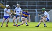 9 July 2019; Paddy Cadell of Tipperary in action against Waterford players, from left, Seán Whelan-Barrett, Ian Beecher, and Tom Barron during the Bord Gáis Energy Munster GAA Hurling Under 20 Championship Semi-Final match between Tipperary and Waterford at Semple Stadium in Thurles, Tipperary. Photo by Piaras Ó Mídheach/Sportsfile