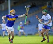 9 July 2019; Jake Morris of Tipperary in action against Tom Looby of Waterford during the Bord Gáis Energy Munster GAA Hurling Under 20 Championship Semi-Final match between Tipperary and Waterford at Semple Stadium in Thurles, Tipperary. Photo by Piaras Ó Mídheach/Sportsfile