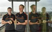 10 July 2019; The PwC GAA/GPA Players of the Month for June, footballer Jamie Brennan of Donegal, and hurler, Diarmuid O'Keeffe of Wexford, were at PwC offices in Dublin today to pick up their respective awards. The players were joined by Billy Sweetman, PwC Wexford, Leinster GAA Chairman, Jim Bolger, and GPA Chief Executive, Paul Flynn. Pictured are Diarmuid O'Keeffe of Wexford. right, and Jamie Brennan of Donegal with their awards at PwC Spencer Dock, North Wall Quay, Dublin 1.  Photo by Sam Barnes/Sportsfile