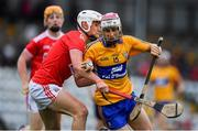10 July 2019; Breffni Horner of Clare is tackled by Eoin Roche of Cork during the Bord Gais Energy Munster GAA Hurling Under 20 Championship semi-final match between Cork and Clare at Páirc Ui Rinn in Cork. Photo by Brendan Moran/Sportsfile