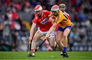 10 July 2019; Breffni Horner of Clare in action against Eoin Roche of Cork during the Bord Gais Energy Munster GAA Hurling Under 20 Championship semi-final match between Cork and Clare at Páirc Ui Rinn in Cork. Photo by Brendan Moran/Sportsfile