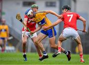 10 July 2019; Diarmuid Ryan of Clare in action against Brian Roche and Robert Downey of Cork during the Bord Gais Energy Munster GAA Hurling Under 20 Championship semi-final match between Cork and Clare at Páirc Ui Rinn in Cork. Photo by Brendan Moran/Sportsfile