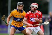 10 July 2019; Conor O'Callaghan of Cork in action against Dylan McMahon? of Clare during the Bord Gais Energy Munster GAA Hurling Under 20 Championship semi-final match between Cork and Clare at Páirc Ui Rinn in Cork. Photo by Brendan Moran/Sportsfile