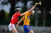 10 July 2019; Diarmuid Ryan of Clare and Ger Millerick of Cork contest possssion during the Bord Gais Energy Munster GAA Hurling Under 20 Championship semi-final match between Cork and Clare at Páirc Ui Rinn in Cork. Photo by Brendan Moran/Sportsfile