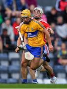 10 July 2019; Mark Rodgers of Clare is tackled by Tommy O'Connell of Cork during the Bord Gais Energy Munster GAA Hurling Under 20 Championship semi-final match between Cork and Clare at Páirc Ui Rinn in Cork. Photo by Brendan Moran/Sportsfile