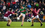 10 July 2019; John Gallagher of Mayo in action against Ciarán Potter, left, and Ross Mahon of Galway during the EirGrid Connacht GAA Football U20 Championship final match between Galway and Mayo at Tuam, Co. Galway. Photo by Sam Barnes/Sportsfile
