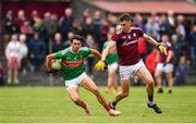 10 July 2019; Oisin Mullin of Mayo in action against Matthew Tierney of Galway during the EirGrid Connacht GAA Football U20 Championship final match between Galway and Mayo at Tuam, Co. Galway. Photo by Sam Barnes/Sportsfile