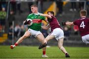 10 July 2019; Eoghan McLaughlin of Mayo in action against Liam Boyle, centre, and Eoghan McFadden of Galway of Galway during the EirGrid Connacht GAA Football U20 Championship final match between Galway and Mayo at Tuam, Co. Galway. Photo by Sam Barnes/Sportsfile