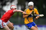 10 July 2019; Aidan McCarthy of Clare in action against Conor O'Callaghan of Cork during the Bord Gais Energy Munster GAA Hurling Under 20 Championship semi-final match between Cork and Clare at Páirc Ui Rinn in Cork. Photo by Brendan Moran/Sportsfile