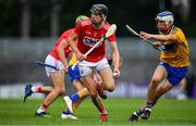 10 July 2019; Robert Downey of Cork in action against Diarmuid Ryan of Clare during the Bord Gais Energy Munster GAA Hurling Under 20 Championship semi-final match between Cork and Clare at Páirc Ui Rinn in Cork. Photo by Brendan Moran/Sportsfile