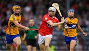10 July 2019; Evan Sheehan of Cork in action against Keith White, lef, and Killian McDermott of Clare during the Bord Gais Energy Munster GAA Hurling Under 20 Championship semi-final match between Cork and Clare at Páirc Ui Rinn in Cork. Photo by Brendan Moran/Sportsfile