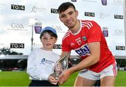 10 July 2019; Brian Turnbull of Cork is presented with his Man of the Match award by Ódhran Bohane, age 8, from Limerick, following the Bord Gais Energy GAA Munster U20 Hurling Championship semi-final between Cork and Clare at Páirc Uí Rinn in Cork. Photo by Brendan Moran/Sportsfile