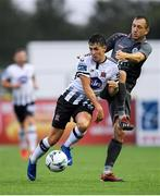 10 July 2019; Jamie McGrath of Dundalk in action against Kriss Kárklins of Riga during the UEFA Champions League First Qualifying Round 1st Leg match between Dundalk and Riga at Oriel Park in Dundalk, Co Louth. Photo by Eóin Noonan/Sportsfile
