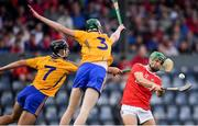 10 July 2019; Brian Turnbull of Cork shoots for a score despit ethe best efforts of Dylan McMahon? and Aron Moloney of Clare during the Bord Gais Energy Munster GAA Hurling Under 20 Championship semi-final match between Cork and Clare at Páirc Ui Rinn in Cork. Photo by Brendan Moran/Sportsfile