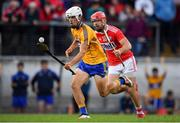 10 July 2019; Aidan McCarthy of Clare in action against Declan Hanlon of Cork during the Bord Gais Energy Munster GAA Hurling Under 20 Championship semi-final match between Cork and Clare at Páirc Ui Rinn in Cork. Photo by Brendan Moran/Sportsfile